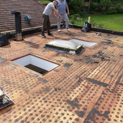 Flat roof stripped, next stage insulation boards.